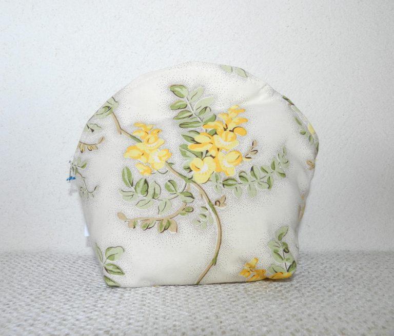 pochette écrue avec fleurs jaunes